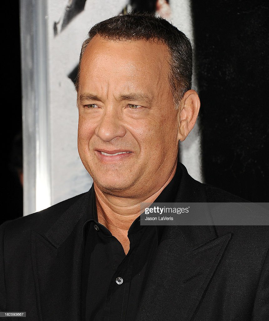 Actor <a gi-track='captionPersonalityLinkClicked' href=/galleries/search?phrase=Tom+Hanks&family=editorial&specificpeople=201790 ng-click='$event.stopPropagation()'>Tom Hanks</a> attends the premiere of 'Captain Phillips' at the Academy of Motion Picture Arts and Sciences on September 30, 2013 in Beverly Hills, California.