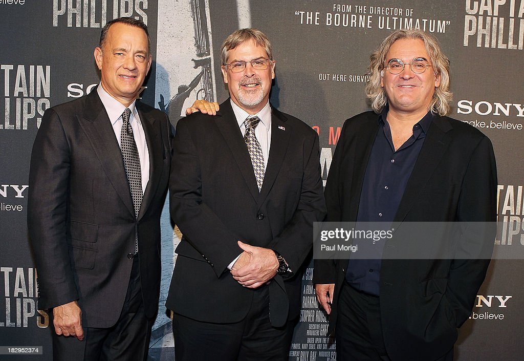 Actor <a gi-track='captionPersonalityLinkClicked' href=/galleries/search?phrase=Tom+Hanks&family=editorial&specificpeople=201790 ng-click='$event.stopPropagation()'>Tom Hanks</a> (L), Captain Richard Phillips and Director <a gi-track='captionPersonalityLinkClicked' href=/galleries/search?phrase=Paul+Greengrass&family=editorial&specificpeople=240256 ng-click='$event.stopPropagation()'>Paul Greengrass</a> arrive at the screening of 'Captain Phillips' at The Newseum on October 2, 2013 in Washington, DC.