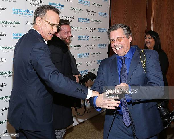 Actor Tom Hanks directs photographers Jamie McCarthy and Kevin Mazur at the SeriousFun Children's Network's New York City Gala at Avery Fisher Hall...