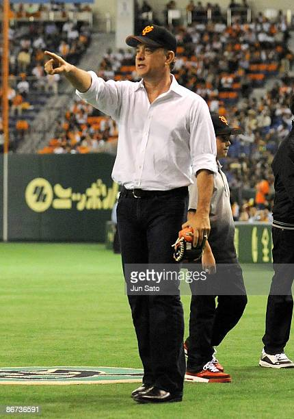 Actor Tom Hanks gestures during the ceremonial first pitch prior to the professional baseball match between Yomiuri Giants and Chunichi Dragons at...