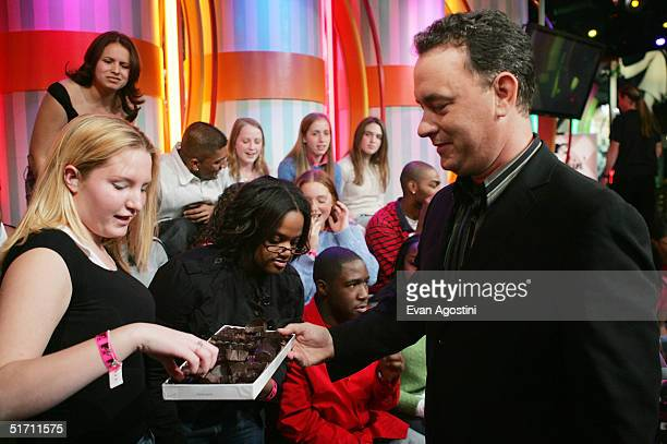 Actor Tom Hanks opens up a box of chocolates on MTV's Total Request Live at the MTV Times Square Studios November 9 2004 in New York City