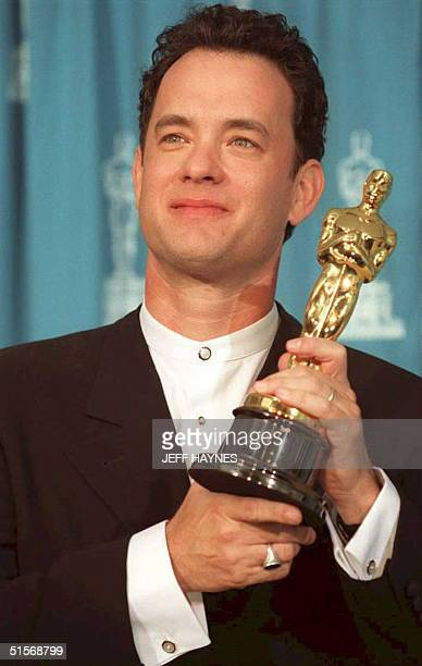 US actor Tom Hanks poses with his Oscar 27 March at the 67th annual Academy Awards in Los Angeles Hanks won as best actor for his portrayal of...