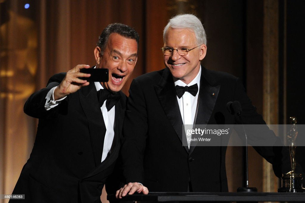 Actor <a gi-track='captionPersonalityLinkClicked' href=/galleries/search?phrase=Tom+Hanks&family=editorial&specificpeople=201790 ng-click='$event.stopPropagation()'>Tom Hanks</a> presents Honoree <a gi-track='captionPersonalityLinkClicked' href=/galleries/search?phrase=Steve+Martin+-+Comedian&family=editorial&specificpeople=196544 ng-click='$event.stopPropagation()'>Steve Martin</a> with honorary award onstage during the Academy of Motion Picture Arts and Sciences' Governors Awards at The Ray Dolby Ballroom at Hollywood & Highland Center on November 16, 2013 in Hollywood, California.