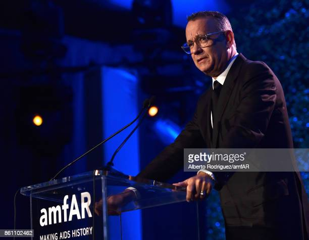 Actor Tom Hanks speaks onstage at the amfAR Gala 2017 at Ron Burkle's Green Acres Estate on October 13 2017 in Beverly Hills California