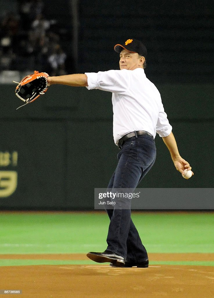 Actor Tom Hanks throws the ceremonial first pitch prior to the professional baseball match between Yomiuri Giants and Chunichi Dragons at Tokyo Dome...