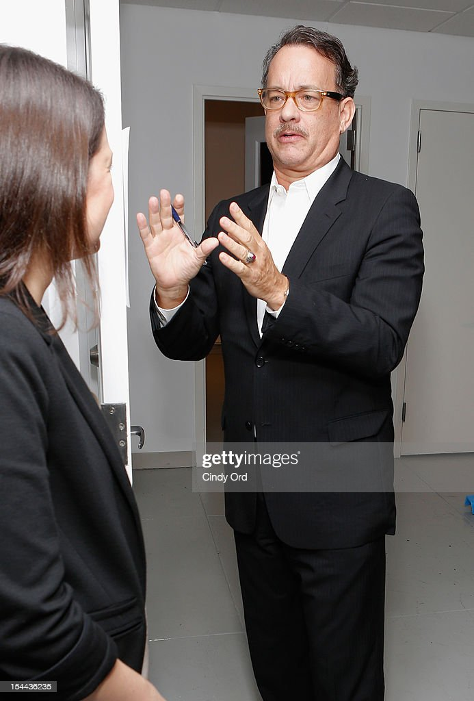 Actor <a gi-track='captionPersonalityLinkClicked' href=/galleries/search?phrase=Tom+Hanks&family=editorial&specificpeople=201790 ng-click='$event.stopPropagation()'>Tom Hanks</a> visits backstage prior to Sherie Rene Scott's performance at 54 Below on October 19, 2012 in New York City.