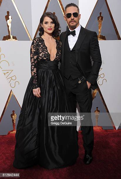 Actor Tom Hardy and Charlotte Riley arrive at the 88th Annual Academy Awards at Hollywood Highland Center on February 28 2016 in Hollywood California