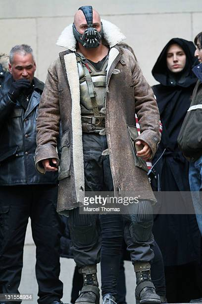 Actor Tom Hardy is seen in costume as Bane on the set of 'The Dark Knight Rises' on location on Wall Street on November 5 2011 in New York City