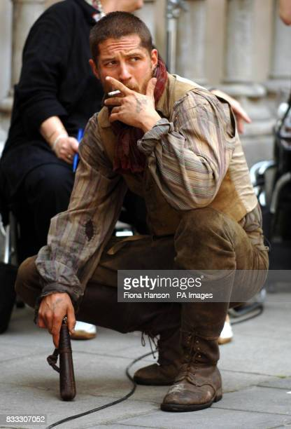 Actor Tom Hardy takes a break from filming his role as Bill Sykes in a BBC production of Oliver Twist scheduled for later this year outside the High...