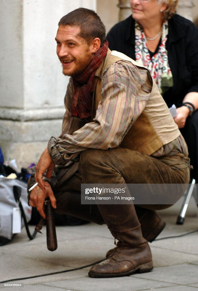 Actor Tom Hardy who was filming his role as Bill Sykes in a BBC production of Oliver Twist scheduled for later this year, outside the High Court in central London today.