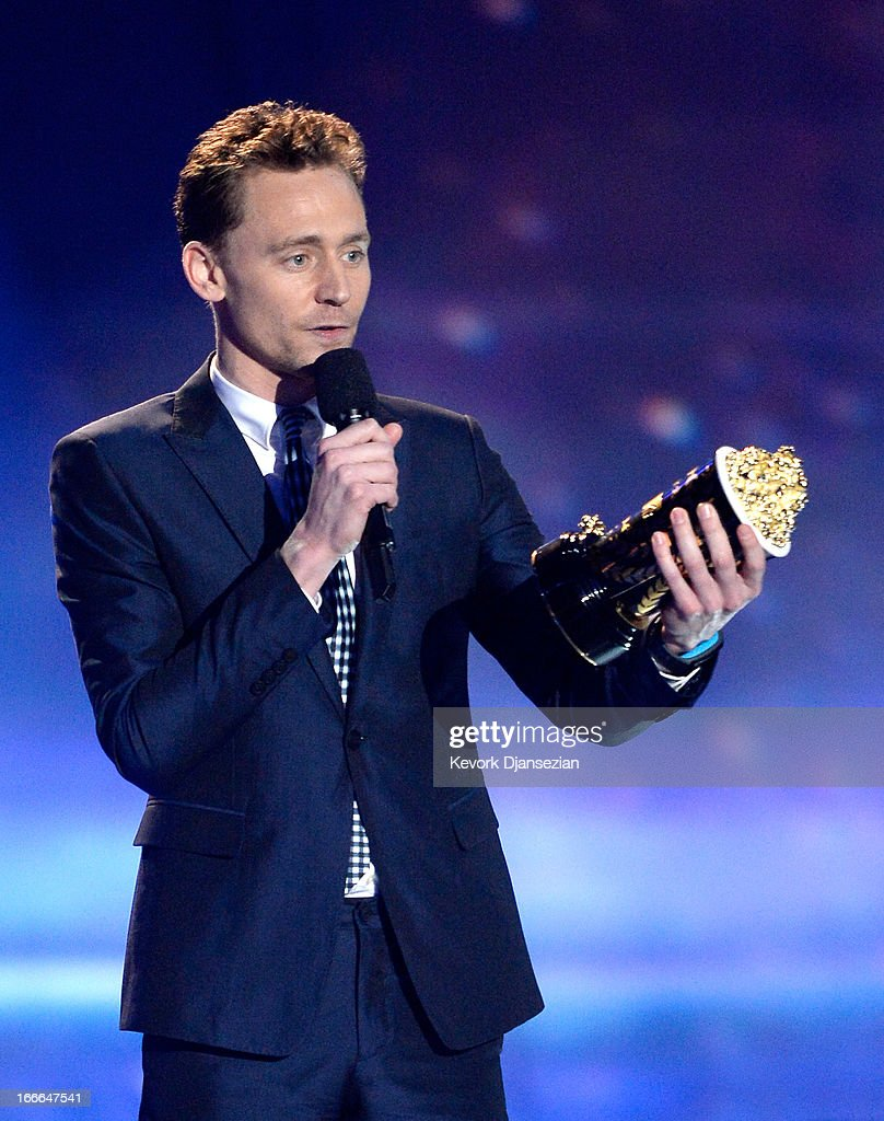 Actor Tom Hiddleston accepts the Best Villain award for 'Marvel's The Avengers' onstage during the 2013 MTV Movie Awards at Sony Pictures Studios on April 14, 2013 in Culver City, California.