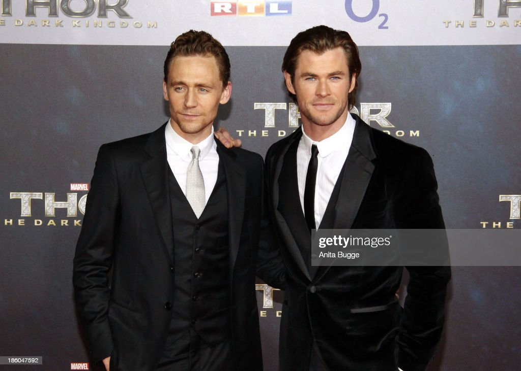 Actor Tom Hiddleston (L) and actor Chris Hemsworth attend the 'Thor: The Dark World' Germany premiere at Cinestar on October 27, 2013 in Berlin, Germany.