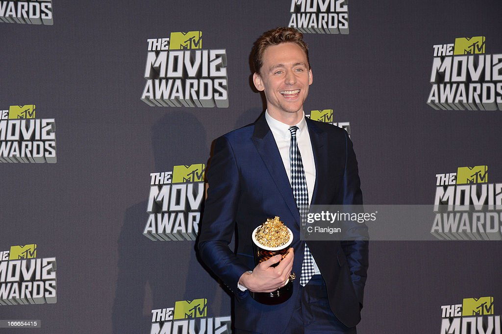 Actor <a gi-track='captionPersonalityLinkClicked' href=/galleries/search?phrase=Tom+Hiddleston&family=editorial&specificpeople=4686407 ng-click='$event.stopPropagation()'>Tom Hiddleston</a> poses backstage during the 2013 MTV Movie Awards at Sony Pictures Studios on April 14, 2013 in Culver City, California.