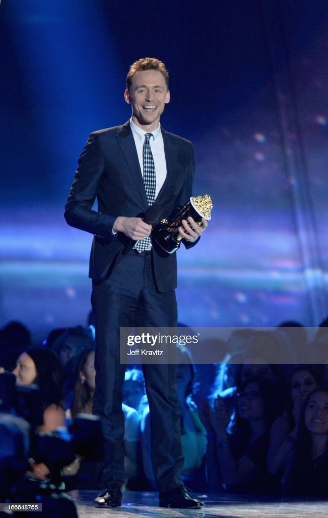 Actor Tom Hiddleston speaks onstage during the 2013 MTV Movie Awards at Sony Pictures Studios on April 14, 2013 in Culver City, California.