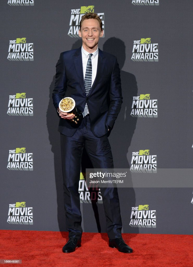 Actor <a gi-track='captionPersonalityLinkClicked' href=/galleries/search?phrase=Tom+Hiddleston&family=editorial&specificpeople=4686407 ng-click='$event.stopPropagation()'>Tom Hiddleston</a>, winner of Best Villain for 'Marvel's The Avengers,' poses in the press room during the 2013 MTV Movie Awards at Sony Pictures Studios on April 14, 2013 in Culver City, California.