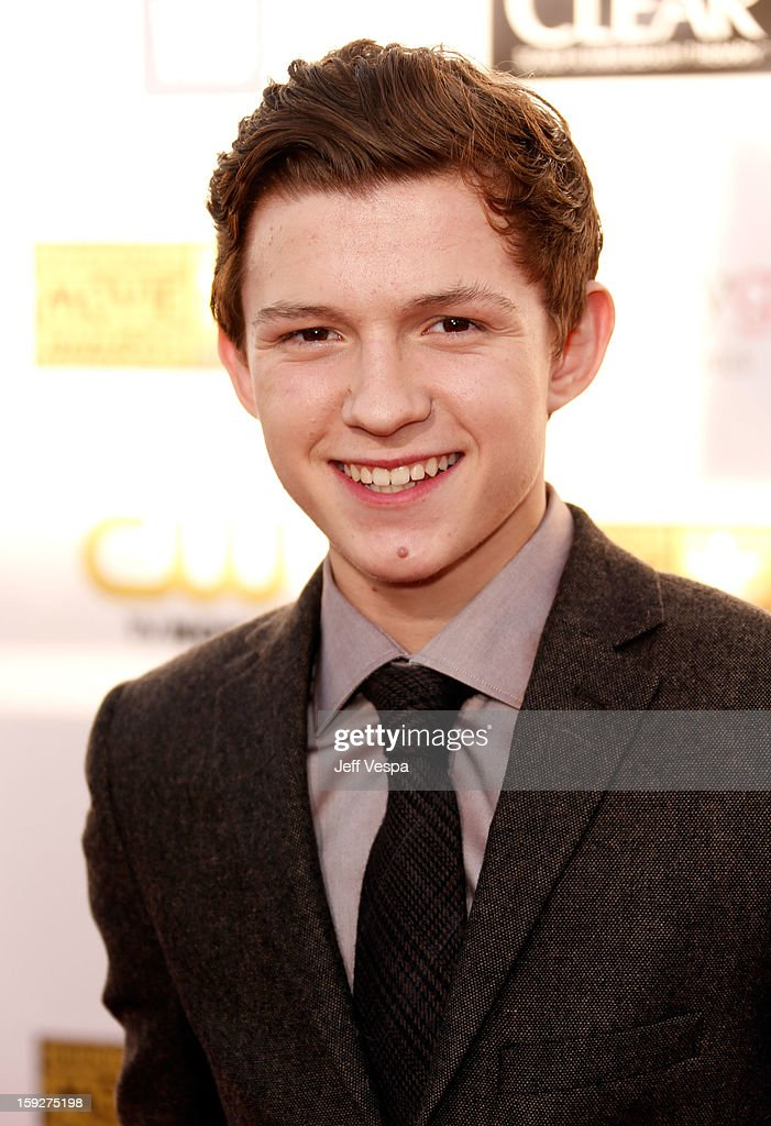 Actor Tom Holland arrives at the 18th Annual Critics' Choice Movie Awards at The Barker Hangar on January 10, 2013 in Santa Monica, California.