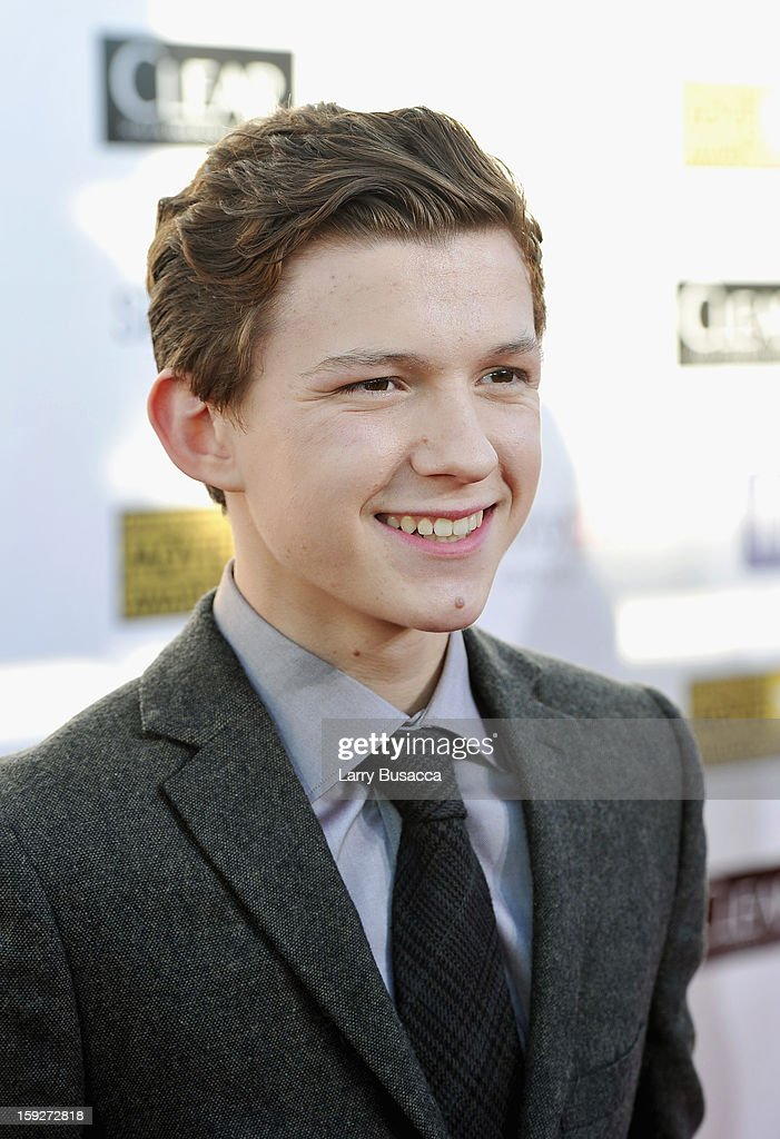 Actor Tom Holland attends the 18th Annual Critics' Choice Movie Awards held at Barker Hangar on January 10, 2013 in Santa Monica, California.