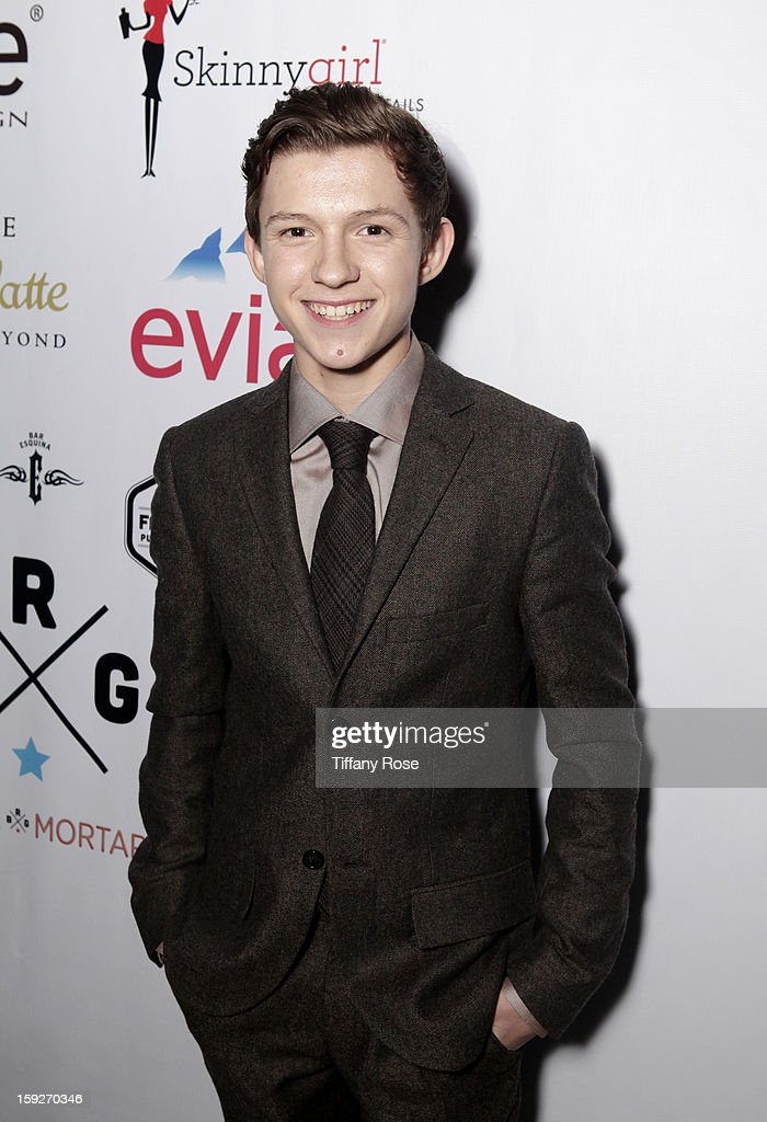 Actor Tom Holland attends the Critics' Choice Movie Awards 2013 with Evian at Barker Hangar on January 10, 2013 in Santa Monica, California.