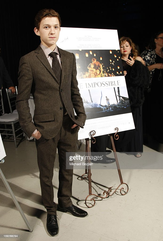 Actor Tom Holland attends the poster signing event for charity during the Critics' Choice Movie Awards 2013 at Barkar Hangar on January 10, 2013 in Santa Monica, California.