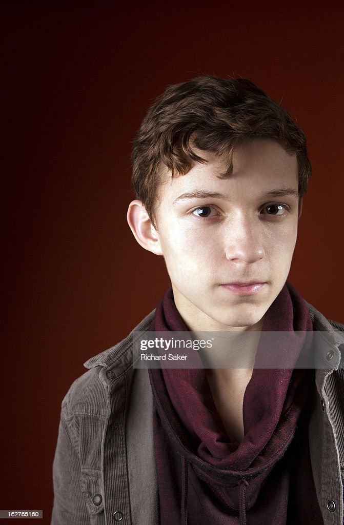 Actor <a gi-track='captionPersonalityLinkClicked' href=/galleries/search?phrase=Tom+Holland+-+Acteur&family=editorial&specificpeople=9843230 ng-click='$event.stopPropagation()'>Tom Holland</a> is photographed for the Observer on December 17, 2013 in London, England.