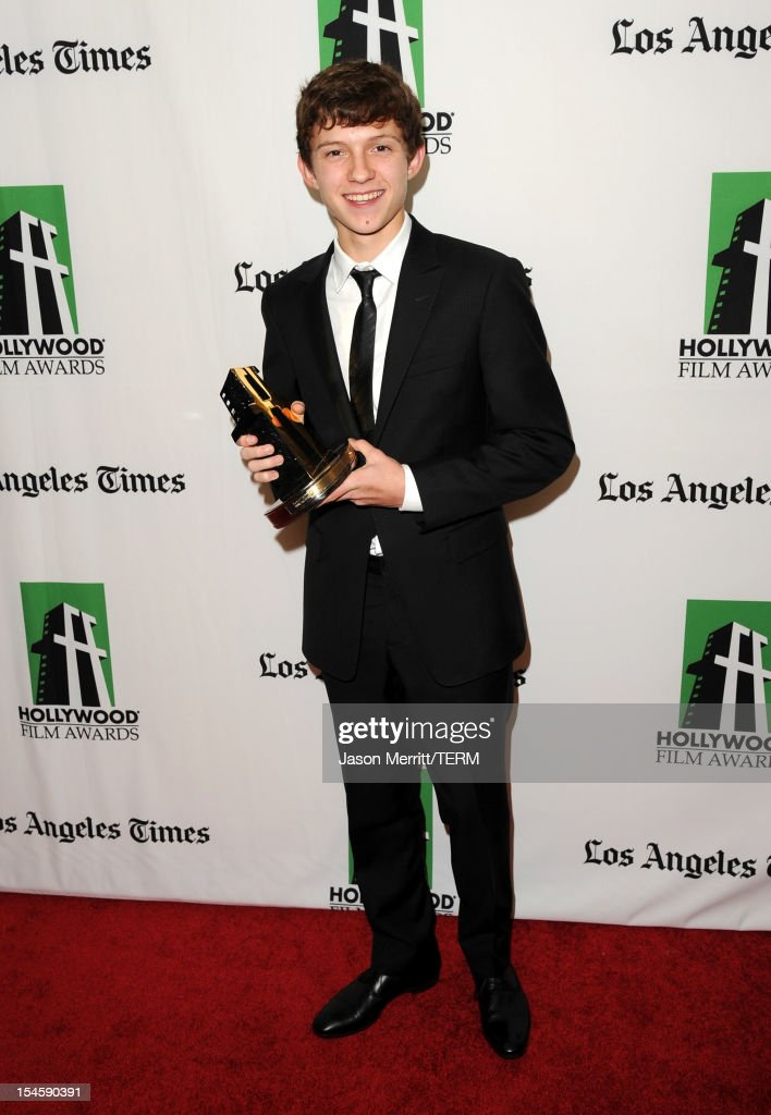 Actor <a gi-track='captionPersonalityLinkClicked' href=/galleries/search?phrase=Tom+Holland+-+Actor&family=editorial&specificpeople=9843230 ng-click='$event.stopPropagation()'>Tom Holland</a> poses with the Hollywood Spotlight Award during the 16th Annual Hollywood Film Awards Gala presented by The Los Angeles Times held at The Beverly Hilton Hotel on October 22, 2012 in Beverly Hills, California.