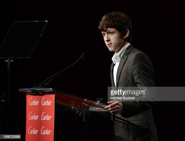 Actor Tom Holland speaks onstage during the 24th annual Palm Springs International Film Festival Awards Gala at the Palm Springs Convention Center on...
