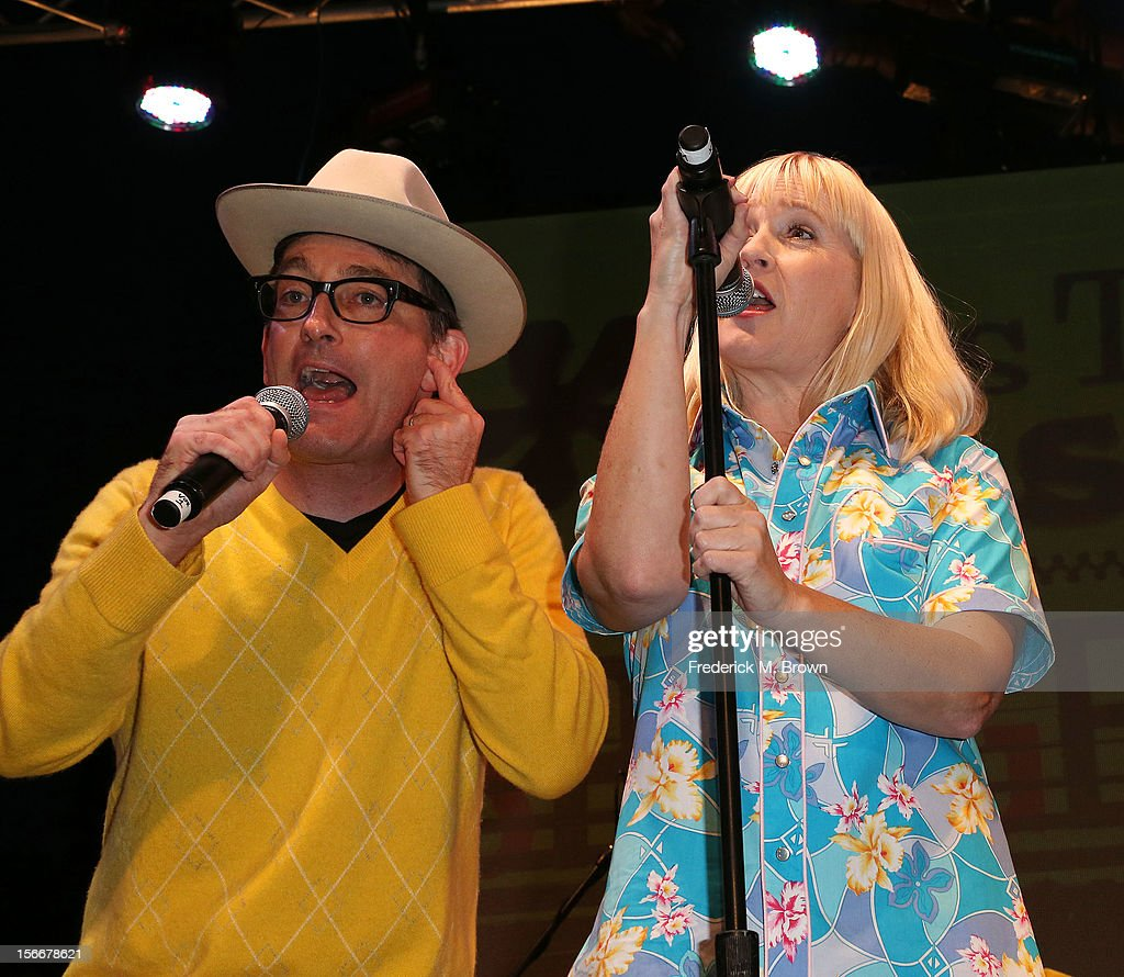 Actor Tom Kenny (L) and actress Carolyn Lawrence perform during Nickelodeon's Spongebob Holiday Extravapants At The Grove on November 18, 2012 in Los Angeles, California.