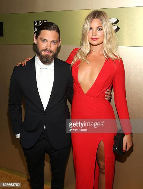 Actor Tom Payne and Jennifer Ackerman attend AMC Networks Emmy Party at BOA Steakhouse on September 18 2016 in West Hollywood California