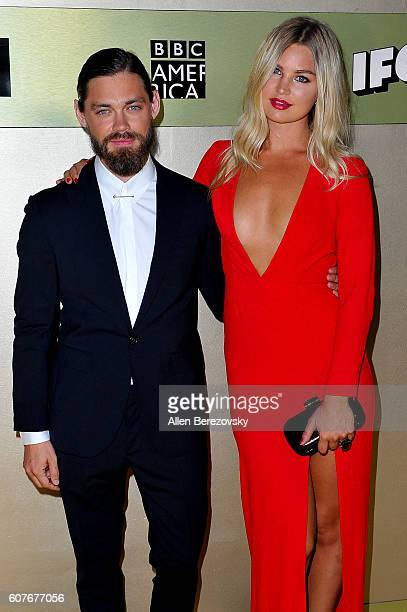Actor Tom Payne and Jennifer Ackerman attends AMC Networks' 68th Primetime Emmy Awards afterparty celebration at BOA Steakhouse on September 18 2016...