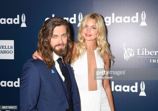 Actor Tom Payne and model Jennifer Akerman attend the 28th Annual GLAAD Media Awards in LA at The Beverly Hilton Hotel on April 1 2017 in Beverly...