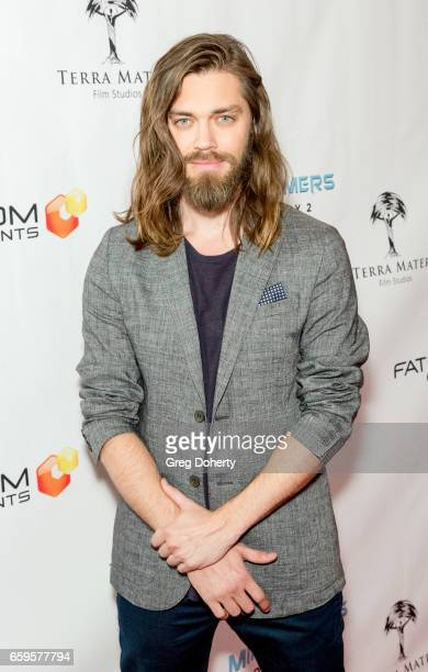 Actor Tom Payne arrives for the Fathom Events And Terra Mater Film Studios Premiere Event For 'MindGamers One Thousand Minds Connected Live' at Regal...