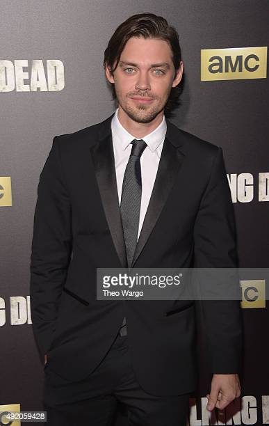 Actor Tom Payne attends the season six premiere of 'The Walking Dead' at Madison Square Garden on October 9 2015 in New York City