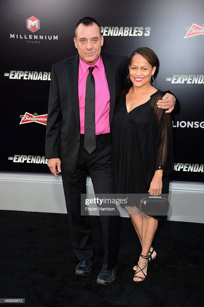 Actor Tom Sizemore and guest attend Lionsgate Films' 'The Expendables 3' premiere at TCL Chinese Theatre on August 11, 2014 in Hollywood, California.