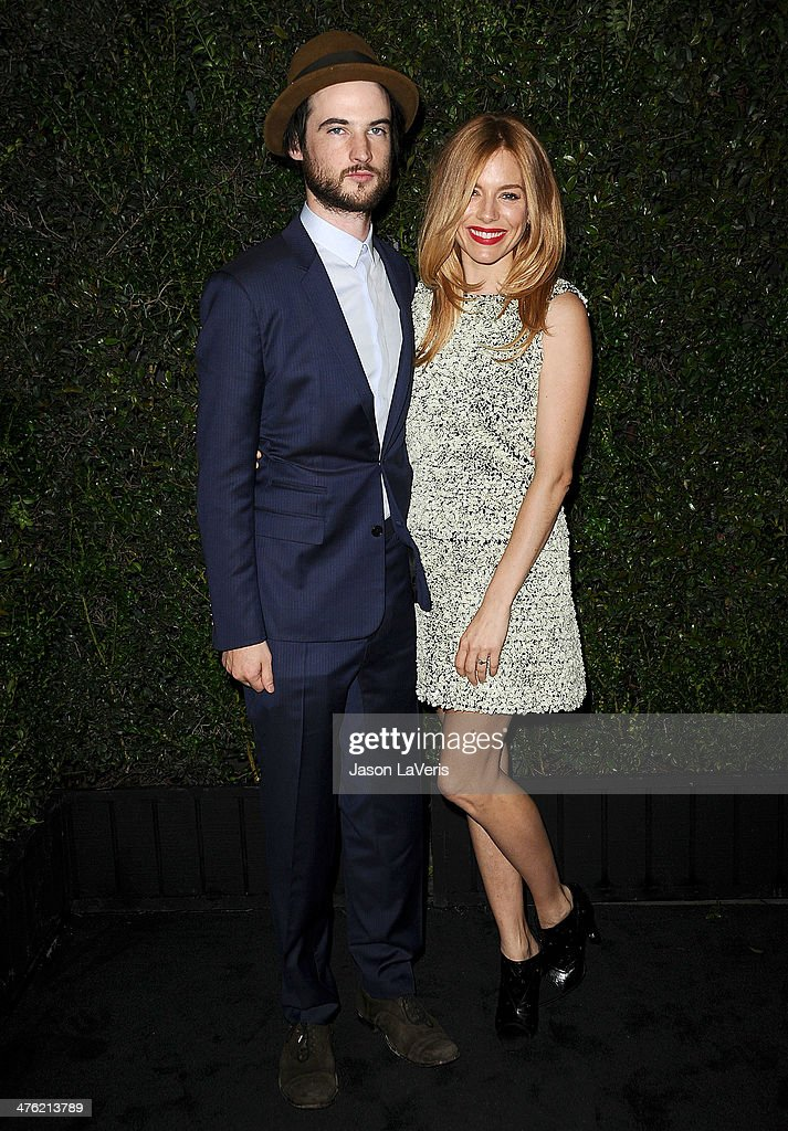 Actor Tom Sturridge and actress Sienna Miller attend the Chanel and Charles Finch pre-Oscar dinner at Madeo Restaurant on March 1, 2014 in Los Angeles, California.
