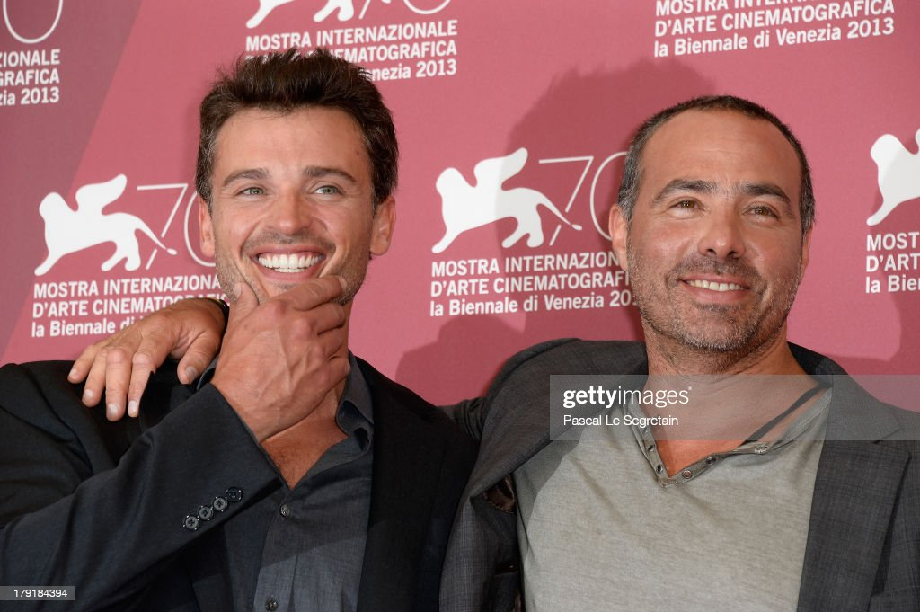 Actor <a gi-track='captionPersonalityLinkClicked' href=/galleries/search?phrase=Tom+Welling&family=editorial&specificpeople=631434 ng-click='$event.stopPropagation()'>Tom Welling</a> and director Peter Landesman attend the 'Parkland' photocall during the 70th Venice International Film Festival at the Palazzo del Casino on September 1, 2013 in Venice, Italy.