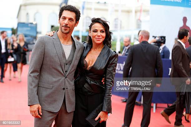 Actor Tomer Sisley and actress Sandra Zeitoun pose on the red carpet during the 42nd Deauville US Film Festival on September 10 2016 in the French...