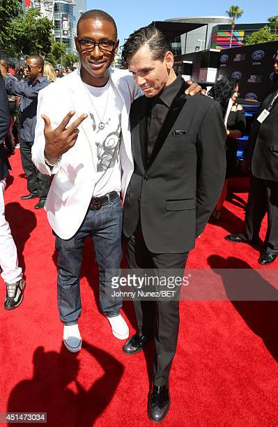 Actor Tommy Davidson and singer El DeBarge attend the BET AWARDS '14 at Nokia Theatre LA LIVE on June 29 2014 in Los Angeles California