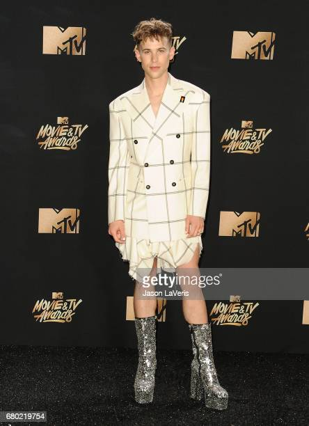 Actor Tommy Dorfman poses in the press room at the 2017 MTV Movie and TV Awards at The Shrine Auditorium on May 7 2017 in Los Angeles California