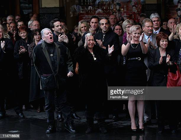 Actor Tommy Dysart and partner Joan Brockenshire and Kate Hunter niece of Bill Hunter farewell the hearse after the memorial service for Australian...