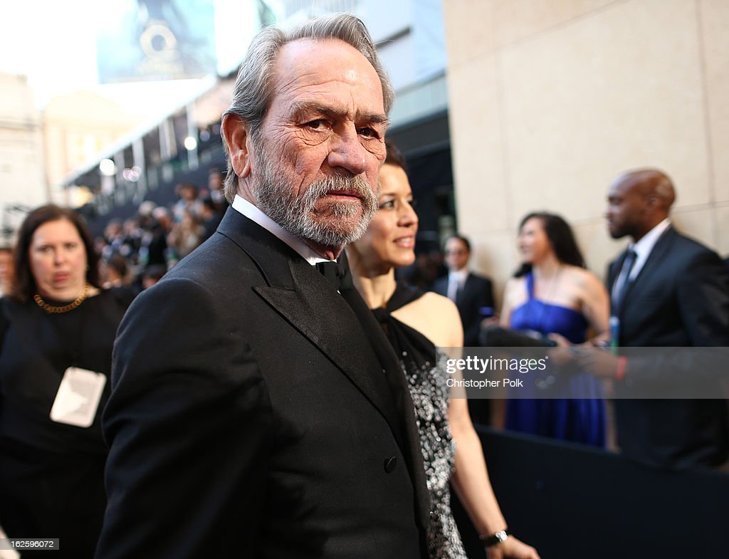 Actor Tommy Lee Jones (L) and Dawn Laurel-Jones arrive at the Oscars held at Hollywood & Highland Center on February 24, 2013 in Hollywood, California.