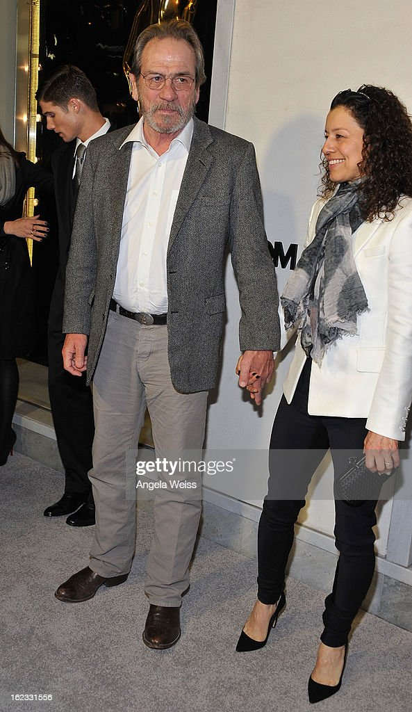 Actor Tommy Lee Jones and his wife Dawn Laurel Jones attend Tom Ford's cocktail event in support of Project Angel Food at TOM FORD on February 21, 2013 in Beverly Hills, California.