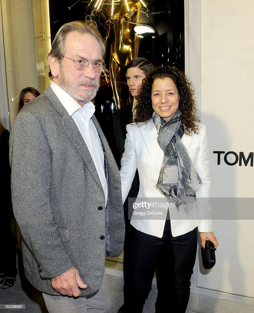 Actor Tommy Lee Jones and wife Dawn Laurel Jones arrive at the Tom Ford cocktail party in support of Project Angel Food at TOM FORD on February 21, 2013 in Beverly Hills, California.