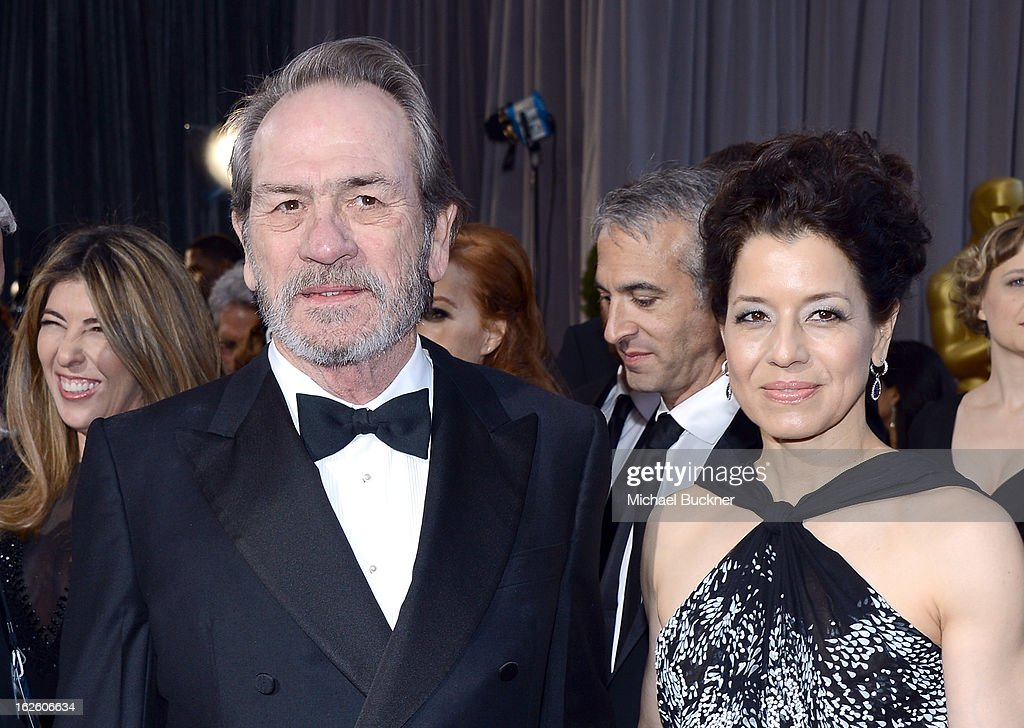 Actor Tommy Lee Jones (L) and wife Dawn Laurel-Jones arrive at the Oscars at Hollywood & Highland Center on February 24, 2013 in Hollywood, California.