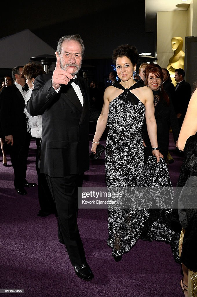 Actor Tommy Lee Jones (L) and wife Dawn Laurel-Jones attend the Oscars Governors Ball at Hollywood & Highland Center on February 24, 2013 in Hollywood, California.