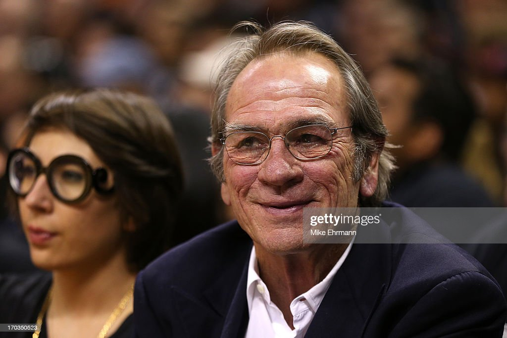 Actor Tommy Lee Jones sits courtside during Game Three of the 2013 NBA Finals between the Miami Heat and the San Antonio Spurs at the AT&T Center on June 11, 2013 in San Antonio, Texas.