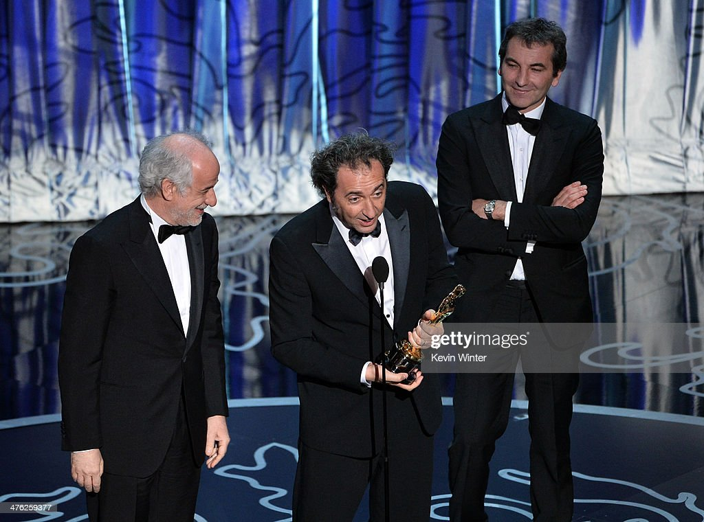 Actor Toni Servillo director Paolo Sorrentino and producer Nicola Giuliano accept the Best Foreign Language Film award for 'The Great Beauty' onstage...