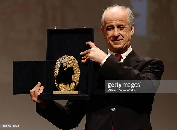 Actor Toni Servillo receives the Marc'Aurelio Jury Award for Best Actor in 'Una Vita Tranquilla' during the Closing Awards Ceremony of the 5th...