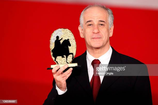 Actor Toni Servillo winner of the Marc'Aurelio Jury Award for Best Actor for 'Una Vita Tranquilla' poses on the red carpet during the Winners...