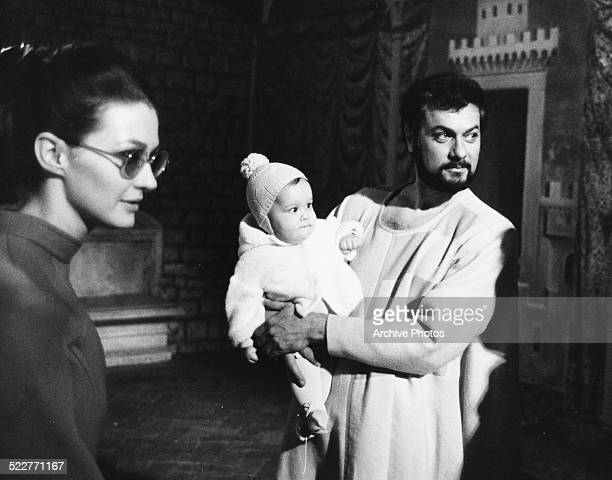 Actor Tony Curtis holding his baby daughter Allegra with his wife Christine Kaufmann on the set of the movie 'On My Way to the Crusades I Met a Girl...