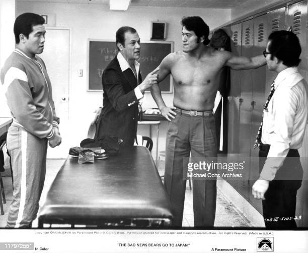 Actor Tony Curtis speaking to bare chested Antonio Inoki in a scene from the film 'The Bad News Bears Go to Japan' 1978